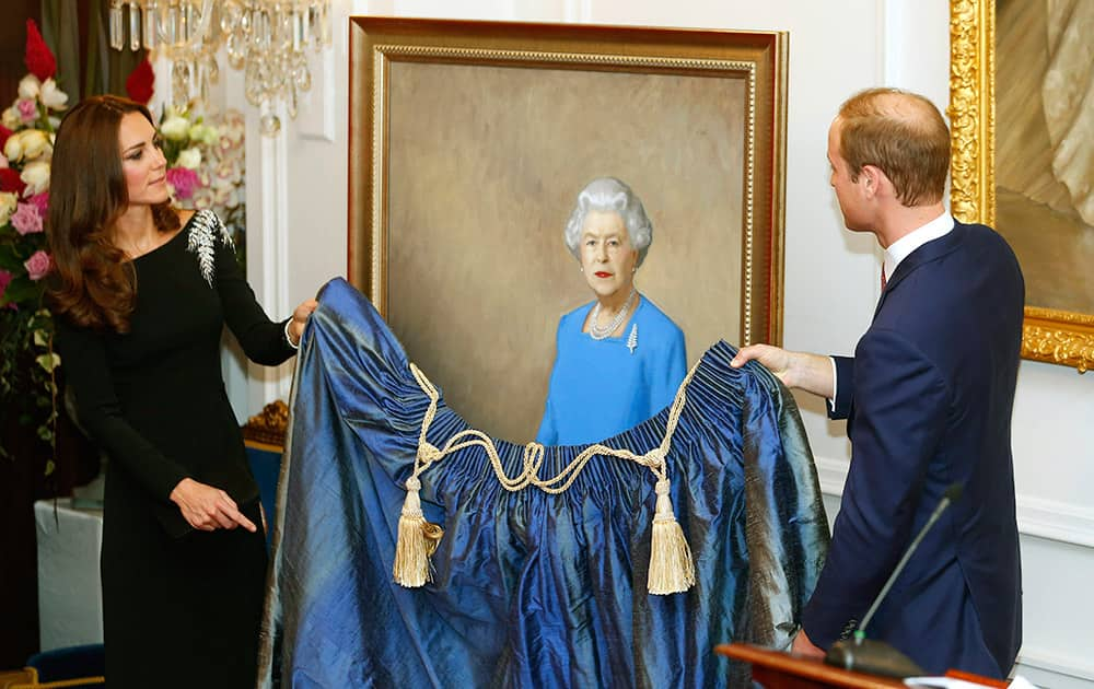 Britain`s Prince William, right, and Kate, the Duchess of Cambridge, unveil a portrait of Queen Elizabeth II, by New Zealand artist Nick Cuthell, during a state reception at Government House in Wellington, New Zealand.