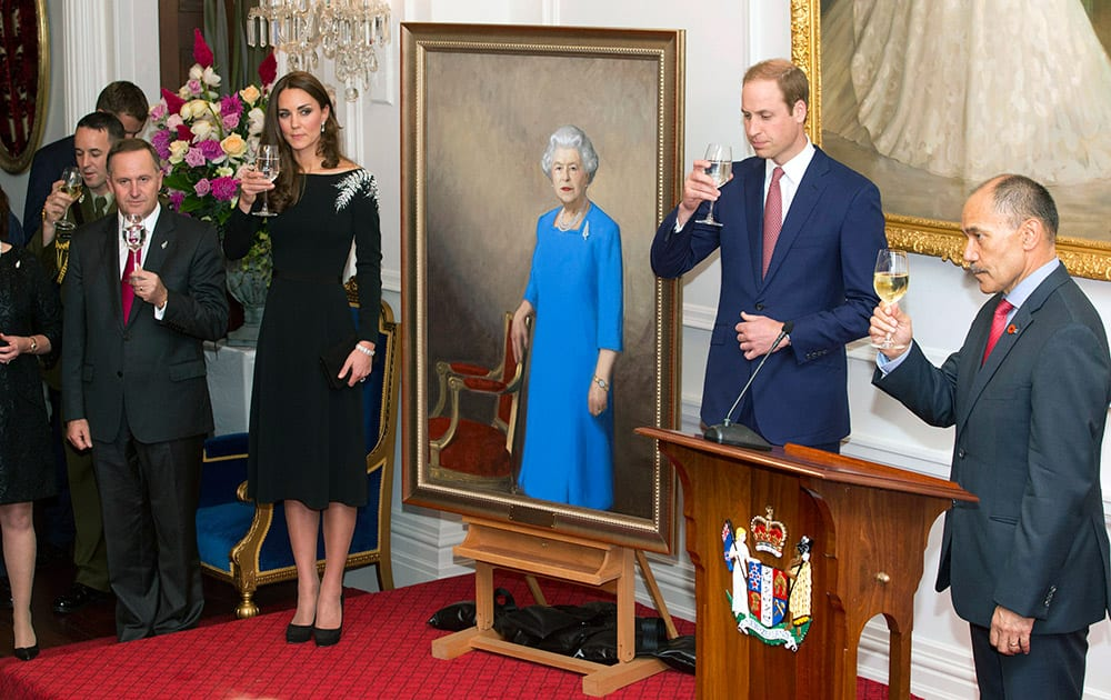 Britain`s Prince William, second right, and his wife Kate, Duchess of Cambridge, along with New Zealand Prime Minister John Key, left, and Governor-General, Sir Jerry Mateparae, right, toast after the unveiling of a portrait of Queen Elizabeth II during a State reception at Government House in Wellington, New Zealand.