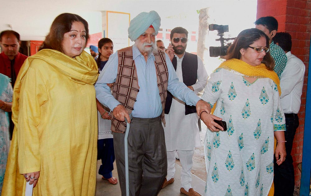 BJP candidate from Chandigarh Kirron Kher with her father 101yrs old Retd. Col. Thakar Singh and sister Kanwal Thakar Singh to cast their vote at a polling station for Lok sabha election 2014 in Chandigarh.