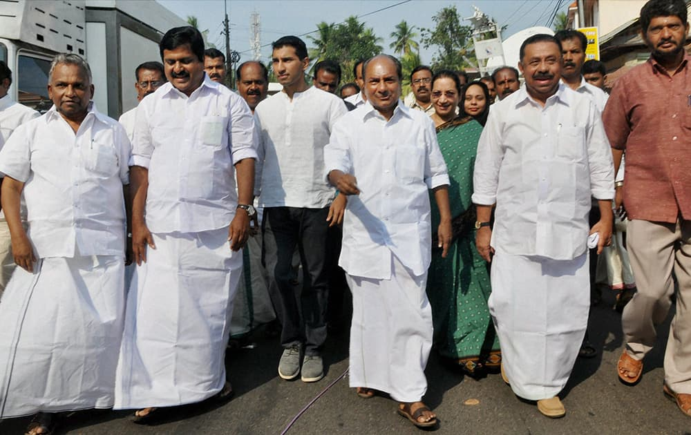 Defence Minister A K Antony arrives to cast his vote for Lok Sabha election at a polling booth in Thiruvananthapuram.