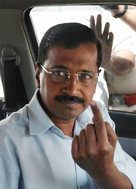 AAP convener Arvind Kejriwal leaves after casting his vote at a polling station at Tilak Marg in New Delhi during voting for the third phase of the Lok Sabha elections.