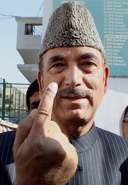 Union Health Minister and Congress candidate from Udhampur Ghulam Nabi Azad shows his ink-marked finger after casting his vote.