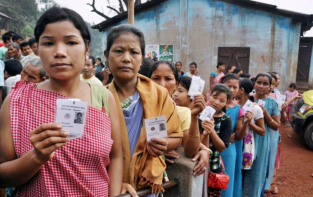 Voters stand in queue to cast their vote for the Second phase of Lok Sabha elections at a polling booth at Barnihat in Ri-Bhoi district of Meghalaya.