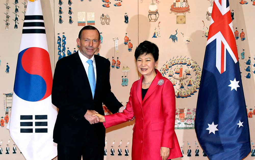 Australian Prime Minister Tony Abbott  shakes hands with his South Korean counterpart Park Geun-hye before their meeting at the presidential house in Seoul, South Korea.