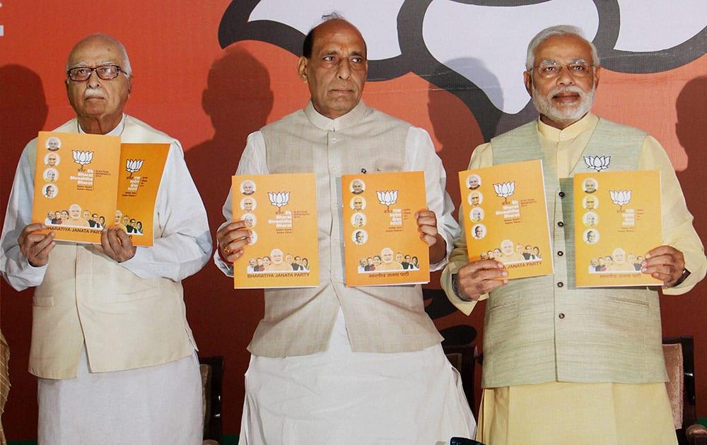 Bharatiya Janata Partys (BJP) Prime Ministerial candidate Narendra Modi (R), Party President Rajnath Singh (C), and senior leader Lal Krishna Advani release the partys election manifesto in New Delhi.