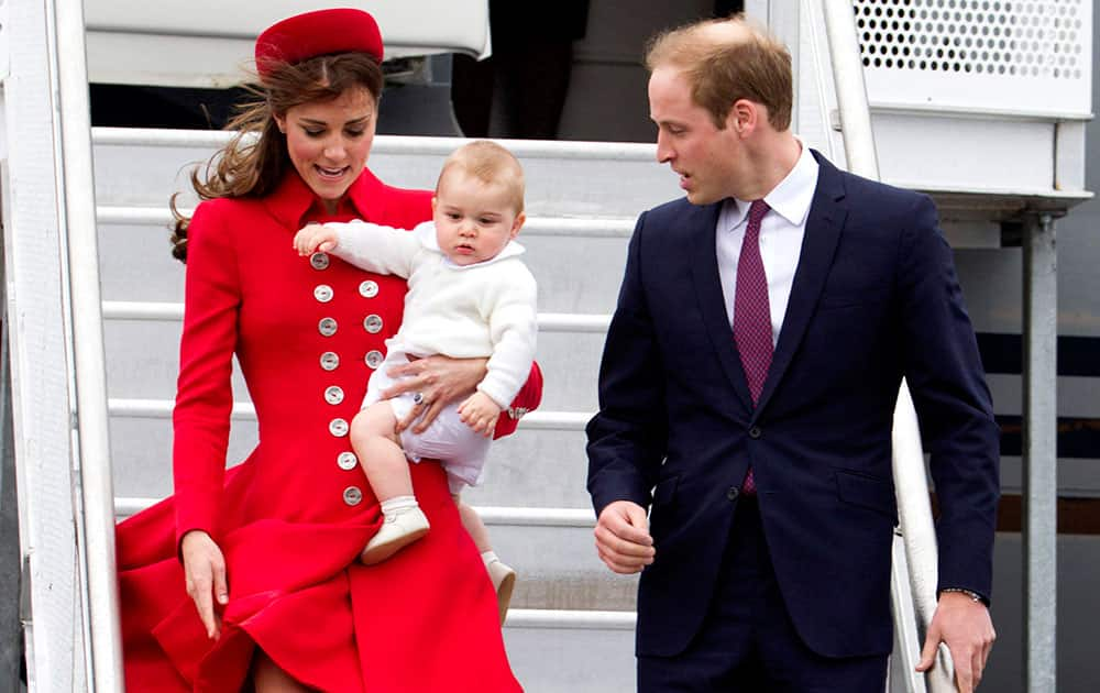 Britain`s Prince William and his wife Kate, the Duchess of Cambridge with Prince George arrive for their visit to New Zealand at the International Airport, in Wellington, New Zealand.