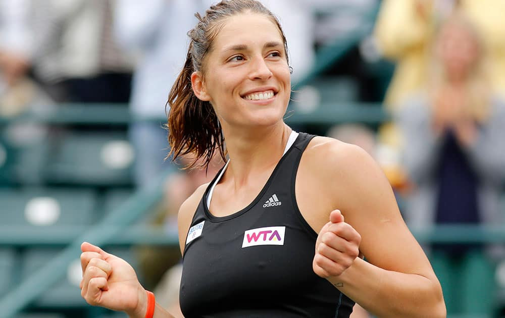 Andrea Petkovic, of Germany, reacts after defeating Jana Cepelova, of Slovakia, in two sets during the Family Circle Cup tennis tournament final in Charleston, S.C.