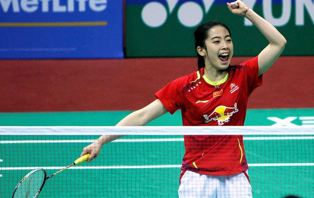 China's Wang Shixian celebrates her victory against Wang Yihan of China during the women's semifinal match at the Yonex Sunrise India Open 2014 badminton tournament in New Delhi.