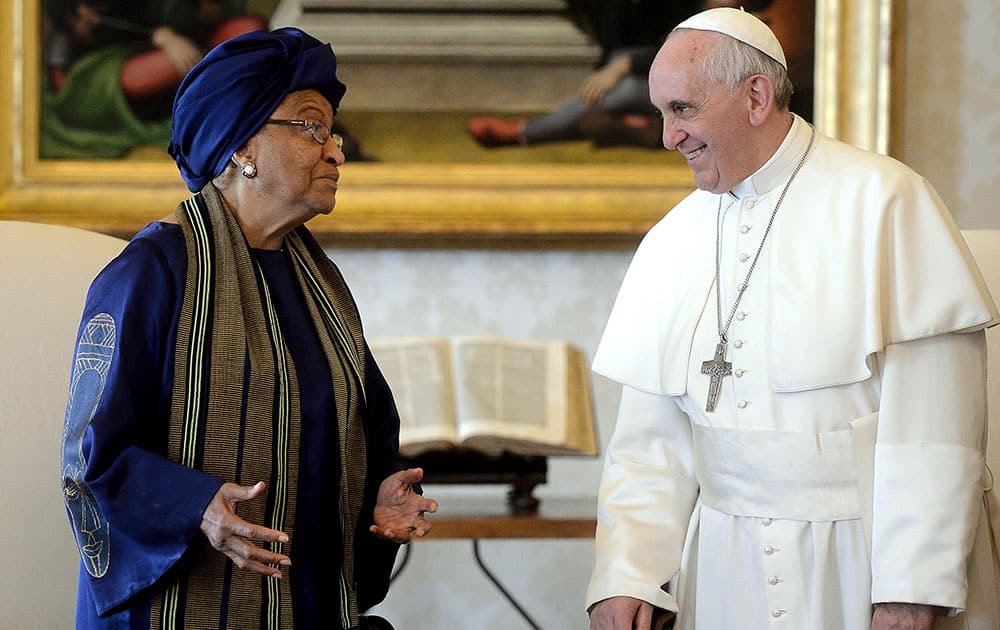 Pope Francis, right, meets Liberia`s President Ellen Johnson Sirleaf during an audience at the Vatican.