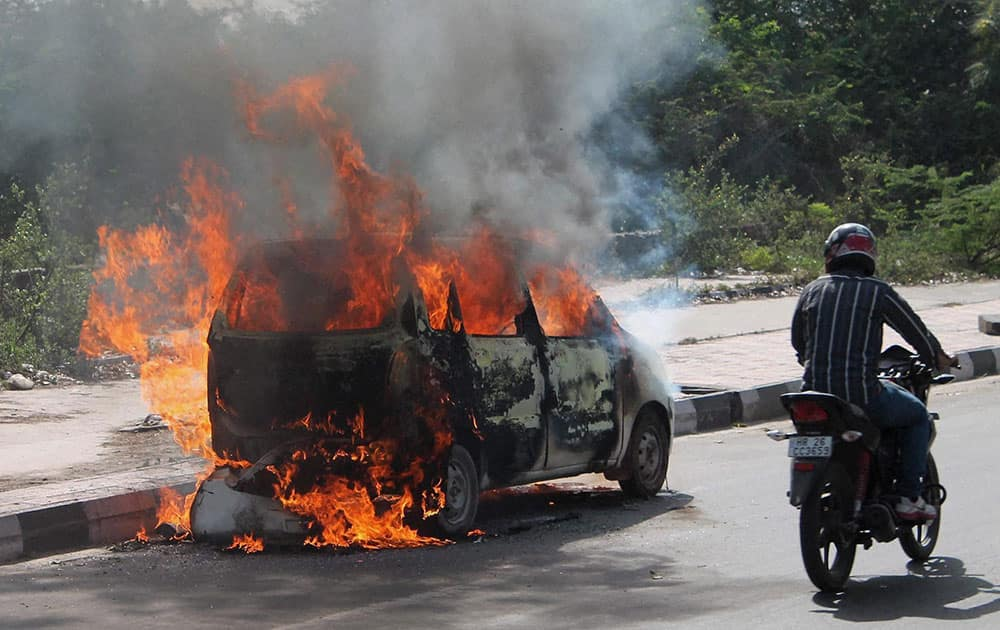 A car catches fire in Faridabad.