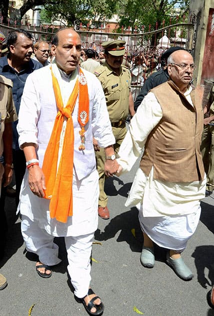 President Rajnath Singh with party leader Lalji Tandon before filing his nomination papers in Lucknow.