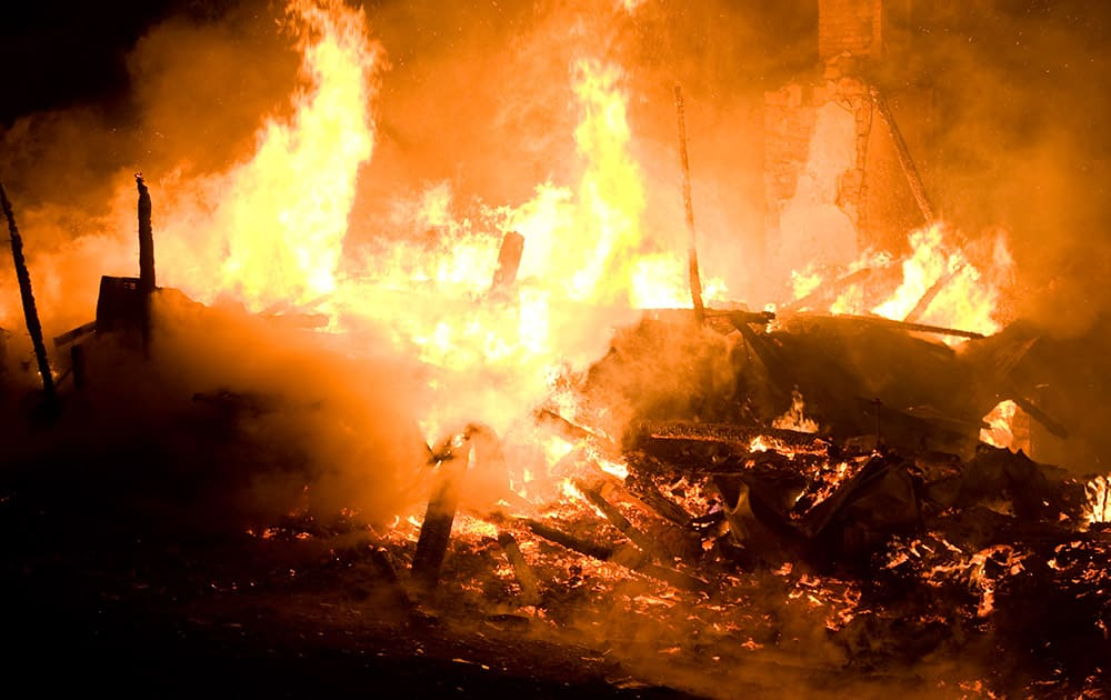 Fire destroys a house on Friday, April 4, 2014 outside Danville, Pa. The early morning farmhouse fire in north-central Pennsylvania killed three children, ages 2 to 13, authorities said.