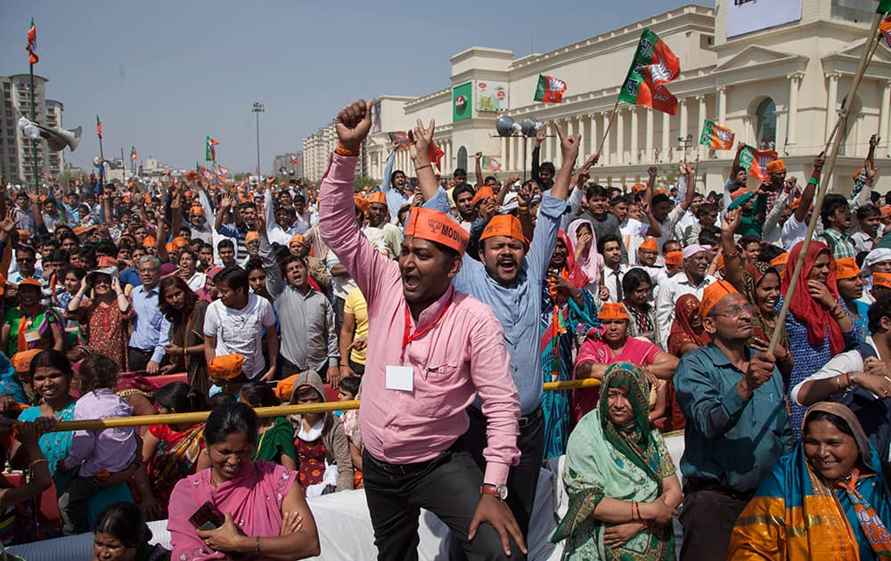 Supporters shout slogans during their prime ministerial candidate Narendra Modi`s election rally in Vaishali, Ghaziabad.