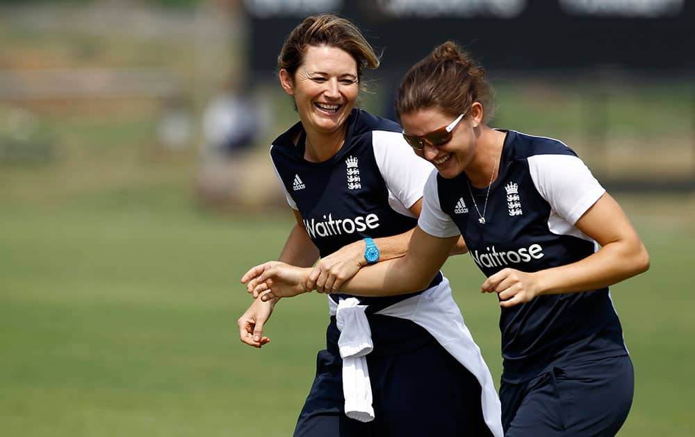 England's women cricket captain Charlotte Edwards, left, and a teammate attend a training session ahead of their ICC Twenty20 Cricket World Cup semi-final match against South Africa in Savar, near Dhaka, Bangladesh.