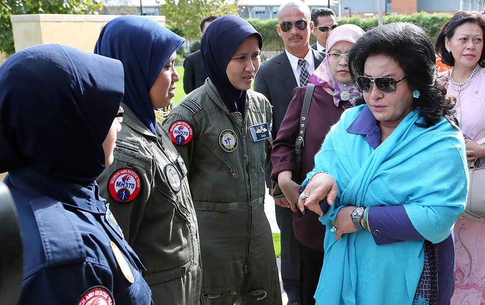 Rosmah Mansor, right, wife of Malaysian Prime Minister Najib Razak meets with aircrew crew members involved in the search for wreckage and debris of the missing Malaysia Airlines flight MH370 in Perth, Australia.