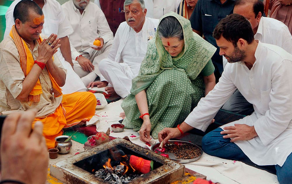 Congress President Sonia Gandhi and Vice President Rahul Gandhi offering puja before filling her nomination in Raebareli.