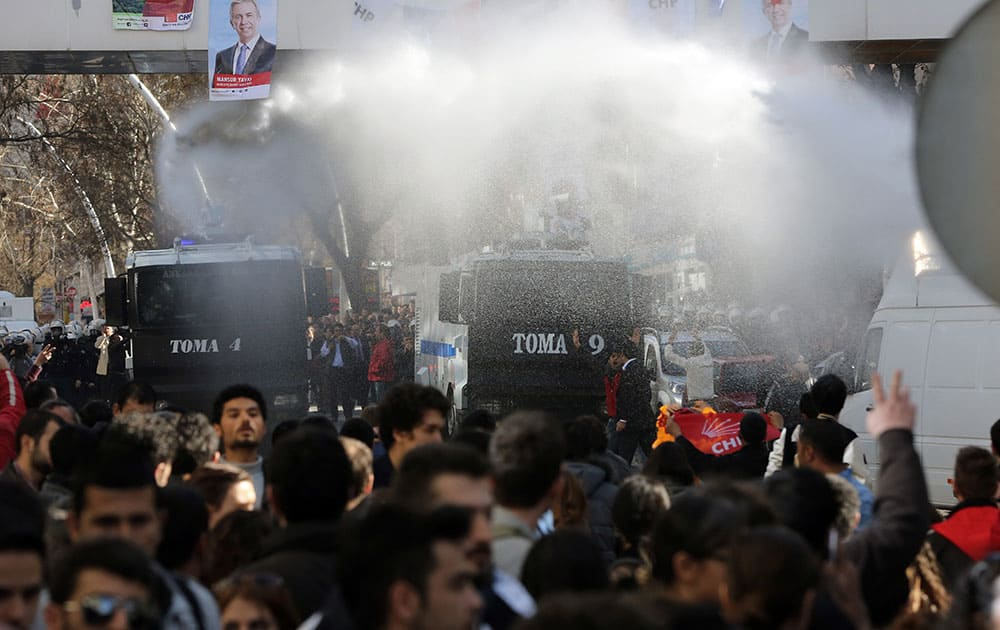 Police use water cannons to break up a protest by hundreds of people who had gathered outside Turkey`s Supreme Election Council building in support of the countryâ??s main opposition party which is challenging local elections results in the capital Ankara, Turkey.
