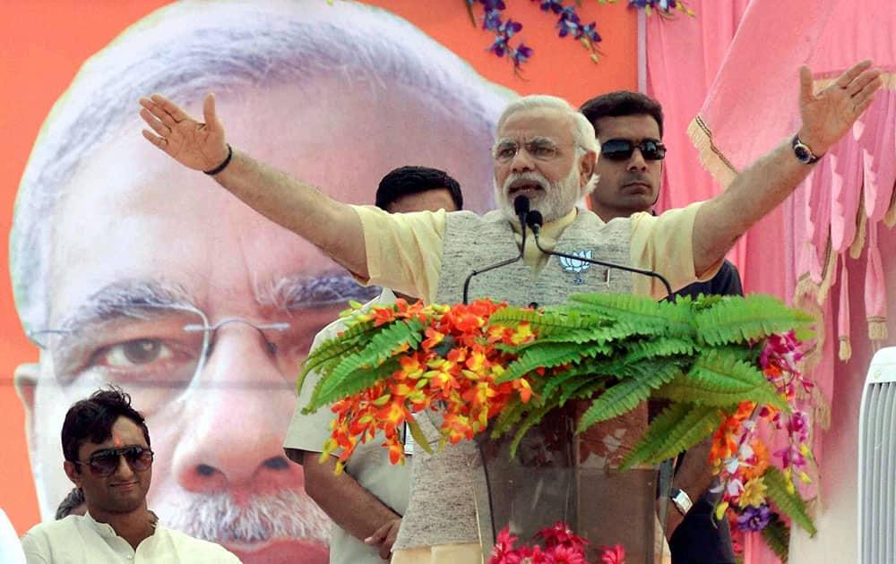 BJP`s Prime Ministerial candidate Narendra Modi addressing an election meeting in Rewa, Madhya Pradesh.