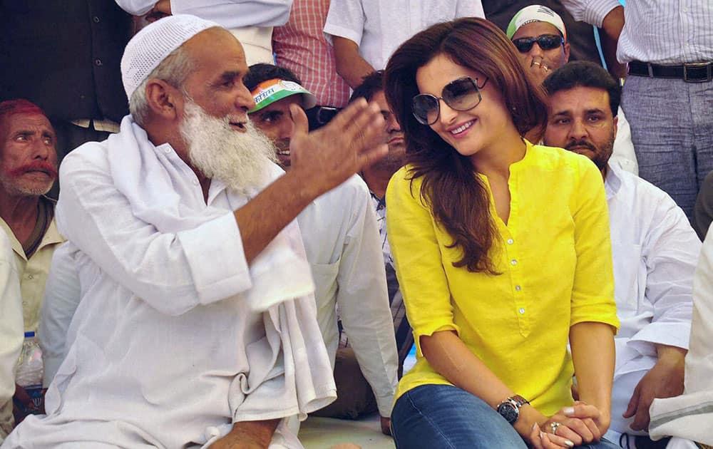 Bollywood actress Monika Bedi campaigning for Congress candidate Acharaya Pramod Krishnam during an election campaign in Sambhal.