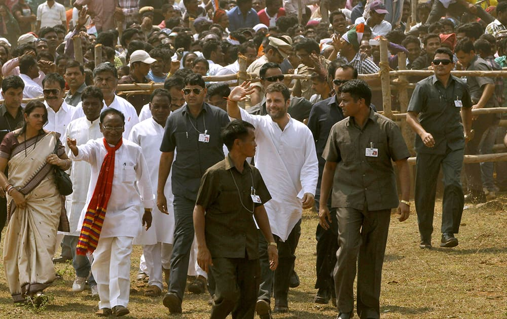 Rahul Gandhi waves to the crowd as he leaves after addressing an election campaign rally at Semiliguda in Koraput district, Orissa.