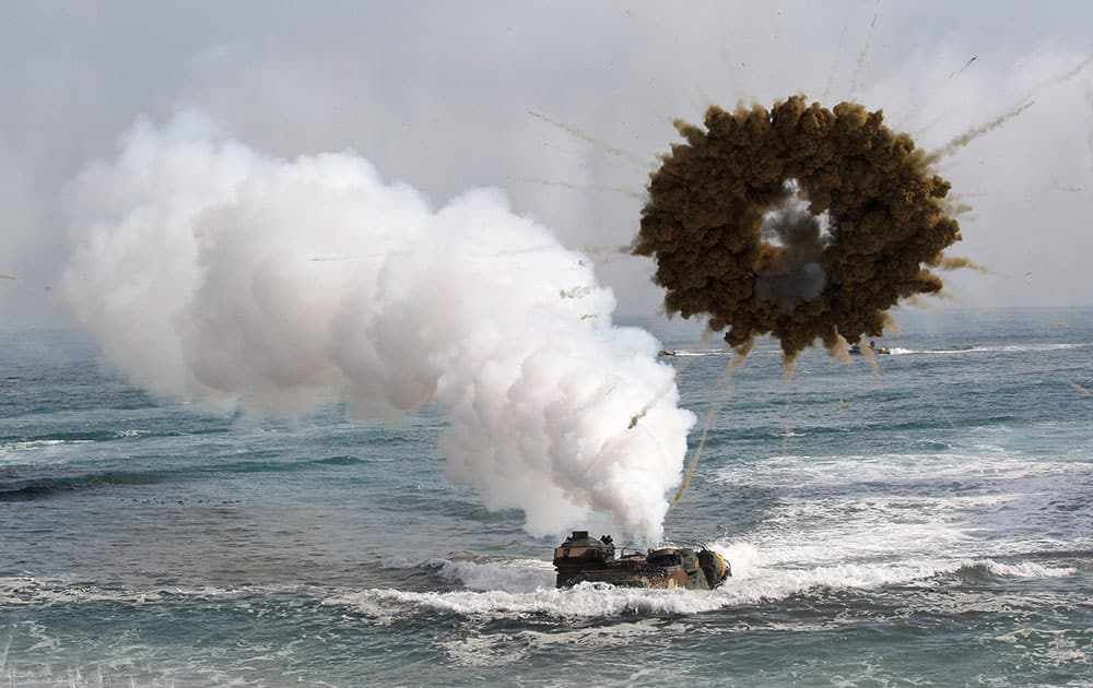 A South Korean marine LVT-7 landing craft sail to shores through a smoke screen during the US-South Korea joint landing exercises called Ssangyong, part of the Foal Eagle military exercises, in Pohang, South Korea.