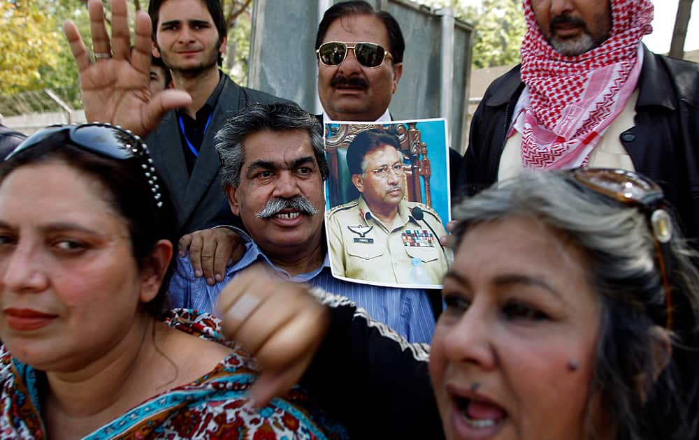 Supporters of the former Pakistani President Pervez Musharraf chant slogans outside the special court in Islamabad, Pakistan.