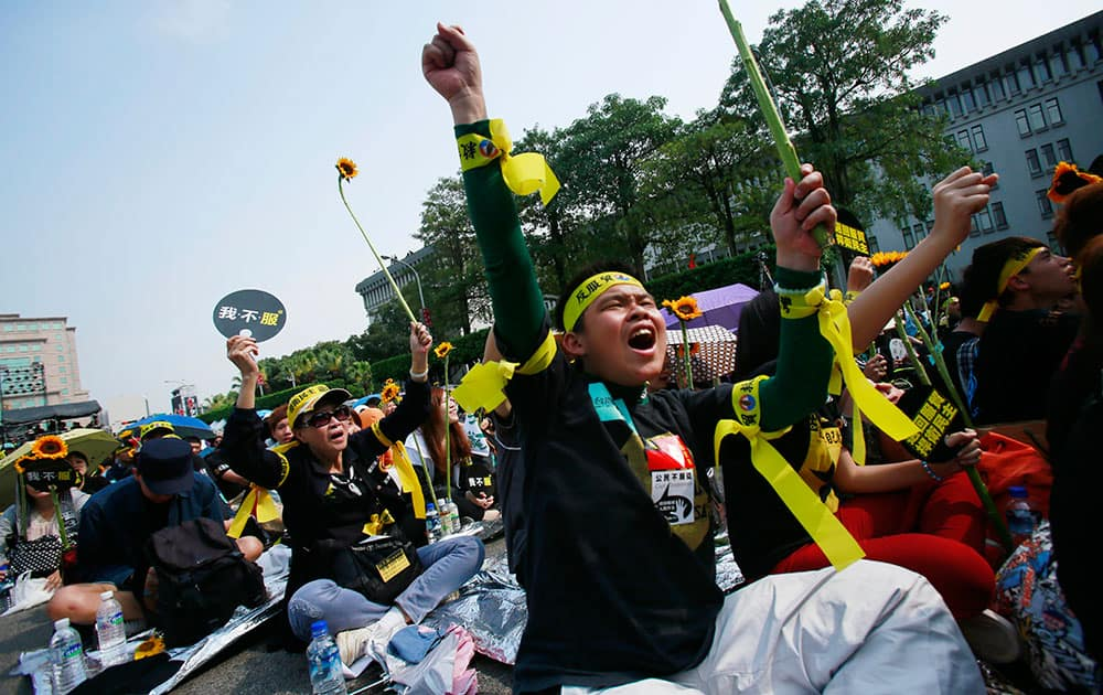 Protesters shout slogans denouncing the controversial China Taiwan trade pact during a massive protest in front of the Presidential Building in Taipei, Taiwan.