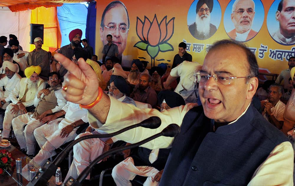 BJP`s candidate from Amritsar Arun Jaitley addresses during an election rally in Majitha village near Amritsar.