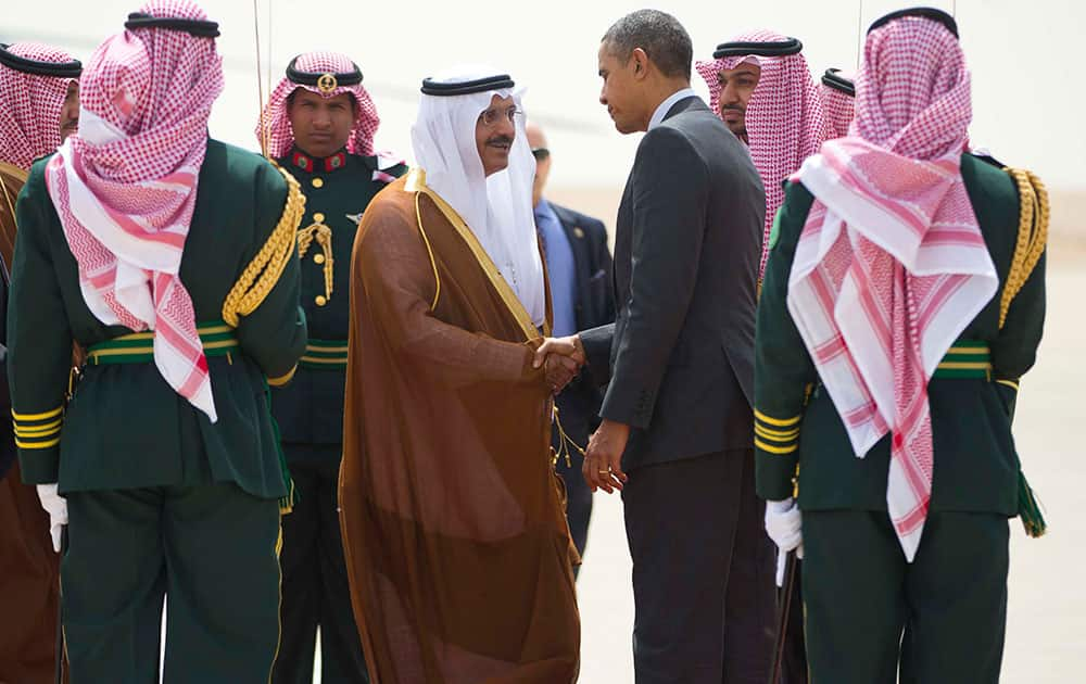 US President Barack Obama shakes hands with the Governor of Riyadh Prince Khalid Bandar bin Abdul-Aziz Al-Saud, center, during his departure on Air Force One at King Khalid International airport in Riyadh, Saudi Arabia.