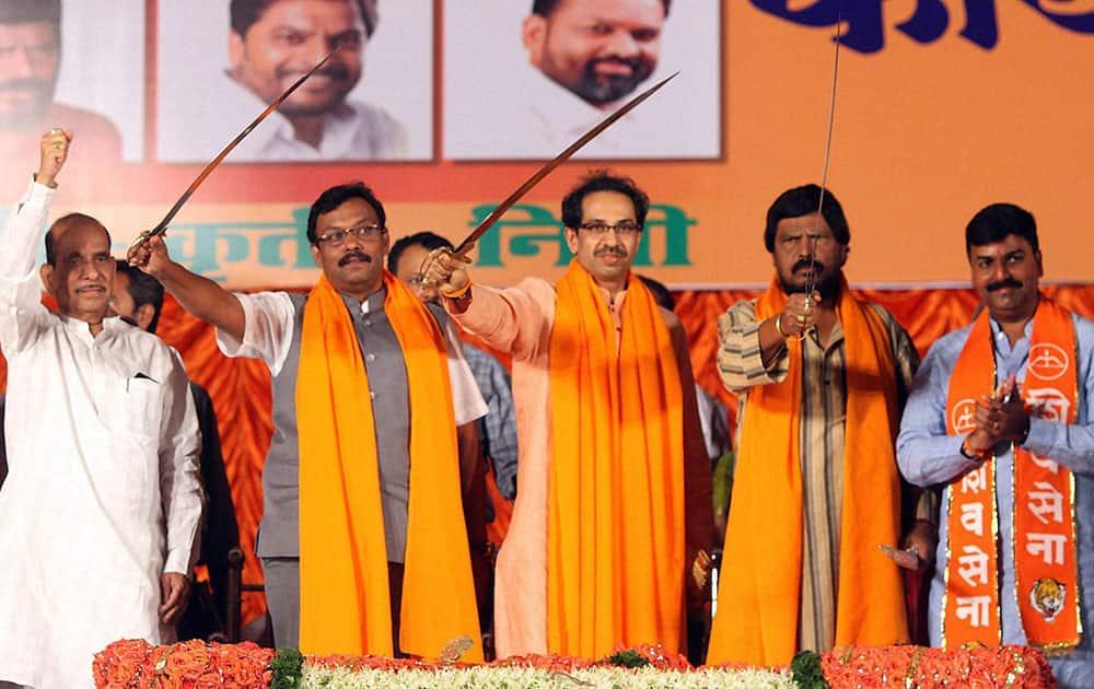 Shiv Sena President Uddhav Thackarey along with former Loksabha speaker Manohar Joshi, BJP leader Vinod Tawde and Shiv Sena central Mumbai candidate during the party working committee meeting in Mumbai.