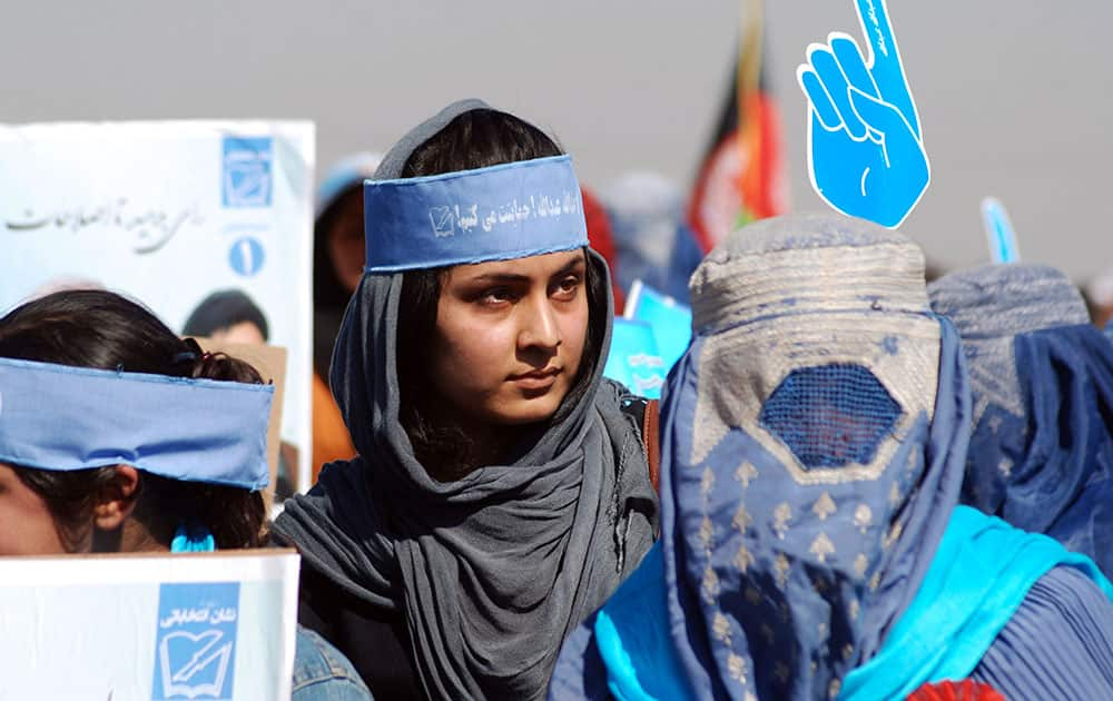 Afghan women attend a campaign rally of presidential candidate Abdullah Abdullah in Mazar-e-Sharif, Afghanistan.