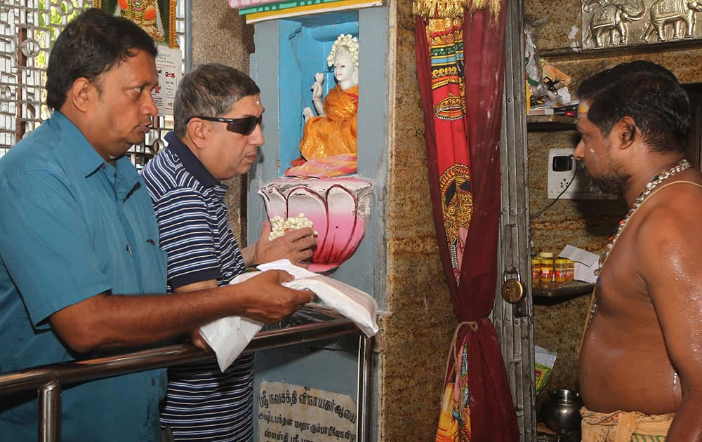 Chairman-designate of the Board of Control of Cricket in India, Narayanaswami Srinivasan, prayers at a temple in Chennai.