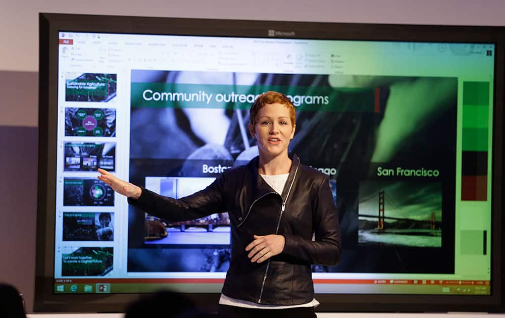 Microsoft General Manager Julia White gestures while talking about the Office 365 app during a press briefing, in San Francisco.