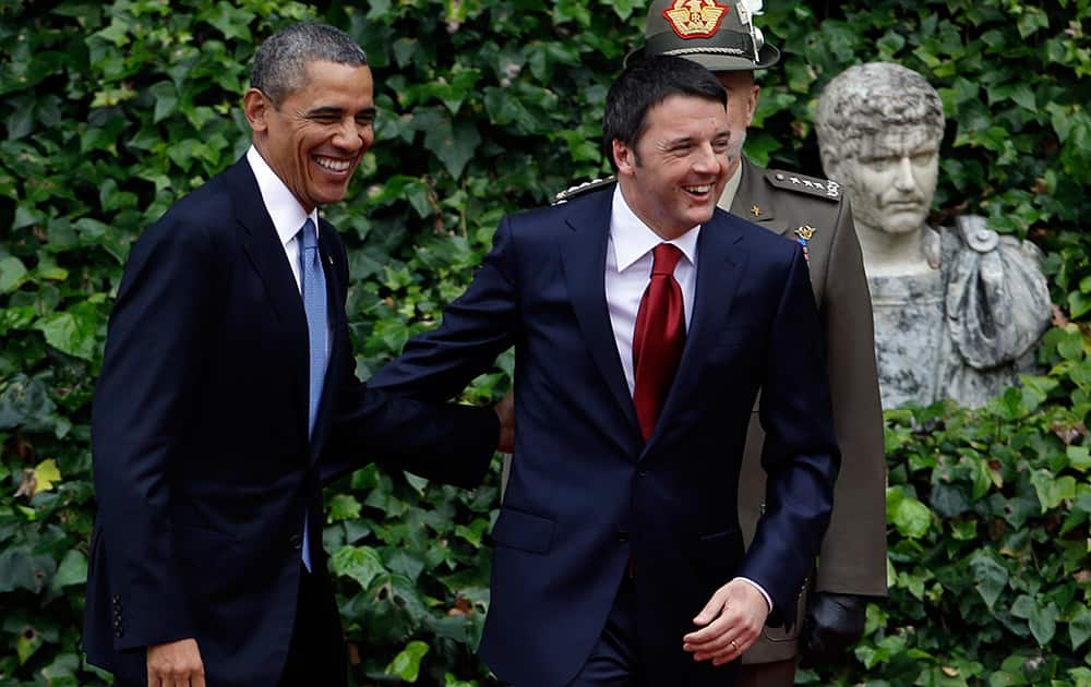 Italian Premier Matteo Renzi and President Barack Obama smile as they arrive at Rome`s Villa Madama for a bilateral meeting.