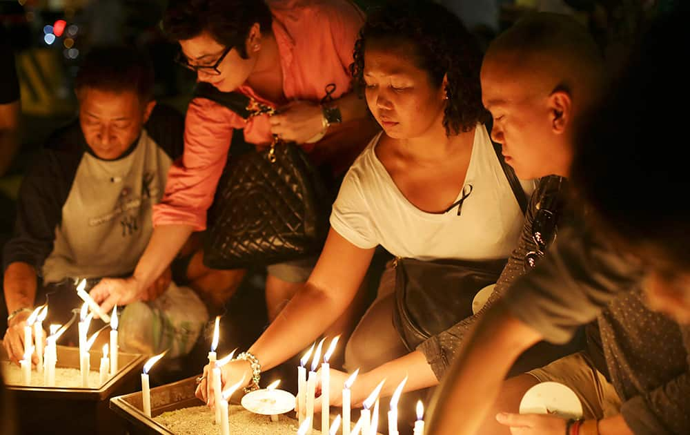People place candles during a ceremony in memory of passengers on board the missing Malaysia Airlines Flight MH370 in Kuala Lumpur, Malaysia.
