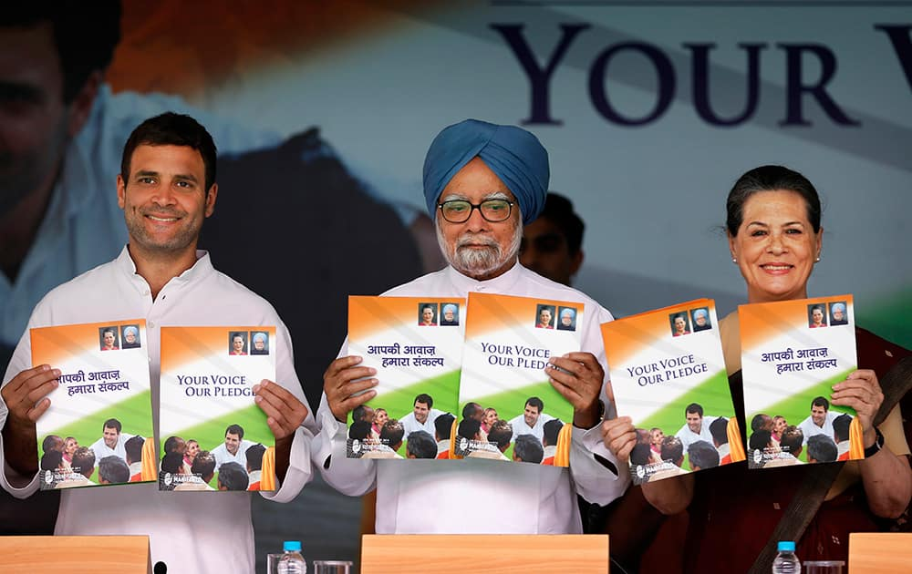 Congress party Vice President Rahul Gandhi, Indian Prime Minister Manmohan Singh, and Congress party President Sonia Gandhi release party manifesto ahead of the general elections, in New Delhi.