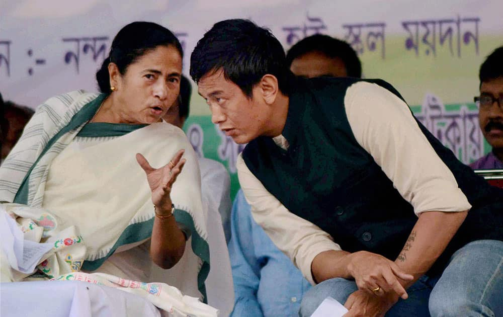 West Bengal Chief Minister and TMC chief Mamata Banerjee with party candidate Baichung Bhutia during an election campaign rally at Naxalbari near Siliguri.