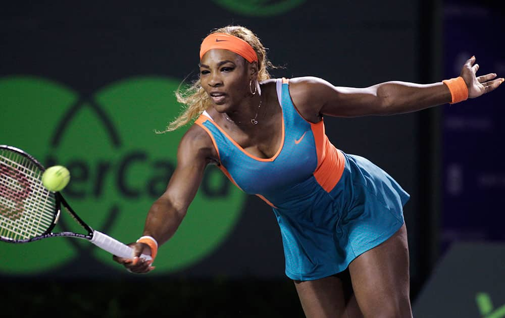Serena Williams, of the United States, returns the ball to Angelique Kerber, of Germany, during the Sony Open tennis tournament.