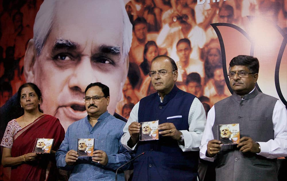 Senior BJP leader Arun Jaitley with other leaders releases the party's poll anthem for the upcoming Lok Sabha poll at party headquarters in New Delhi.