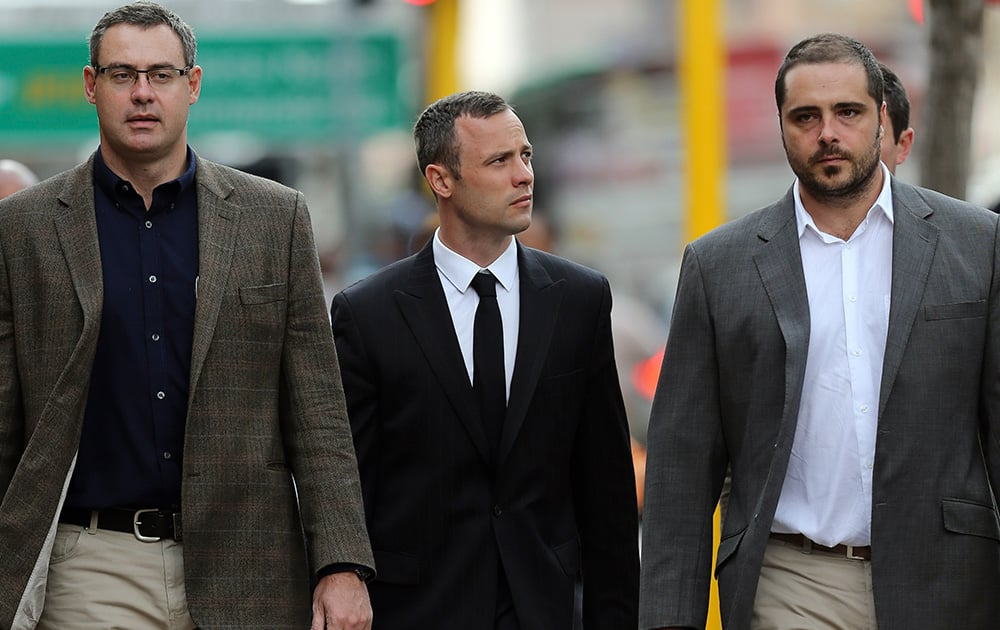 Oscar Pistorius arrives with relatives at the high court in Pretoria, South Africa. Pistorius is charged with murder for the shooting death of his girlfriend Reeva Steenkamp on Valentine`s Day in 2013.