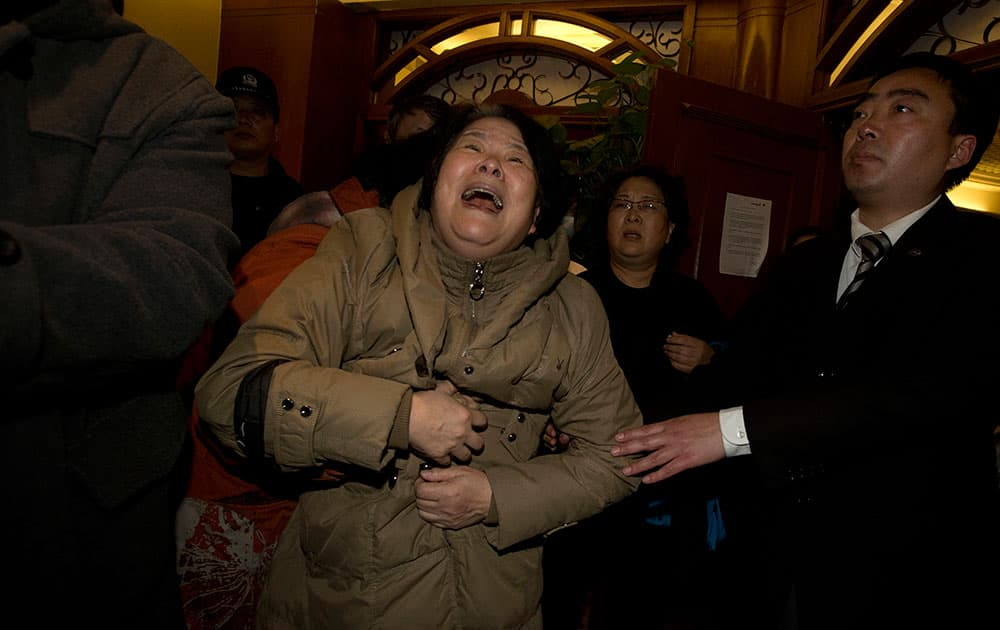 A relative of one of the Chinese passengers aboard the Malaysia Airlines jet, MH370 grieves after being told of the latest news in Beijing, China.