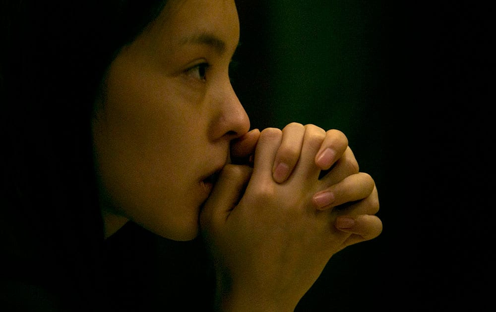 A woman waits outside a room amongst journalists waiting for relatives of the Chinese passengers onboard the missing Malaysia Airlines plane at a hotel in Beijing.