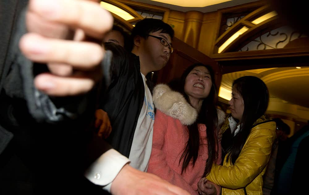 Relatives of Chinese passengers aboard the Malaysia Airlines, MH370 grieve after being told of the latest news in Beijing.