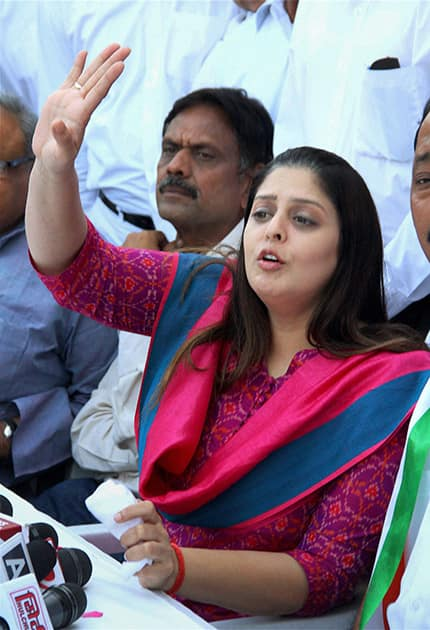 Congress candidate Nagma addresses a press conference in Meerut.
