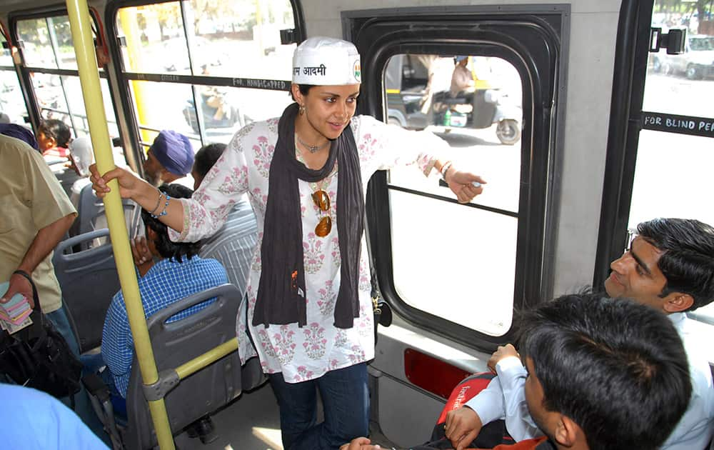 Aam Aadmi Party nominee and former Miss India Gul Panag campaigns on a public bus in Chandigarh.