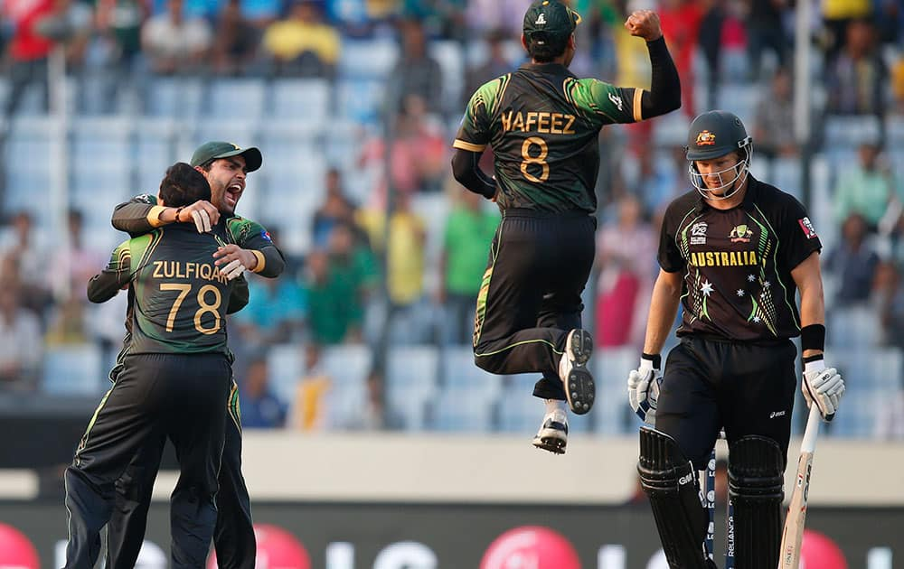 Pakistan players celebrate the dismissal of Australia`s batsman Shane Watson, right, during their ICC Twenty20 Cricket World Cup match in Dhaka, Bangladesh.