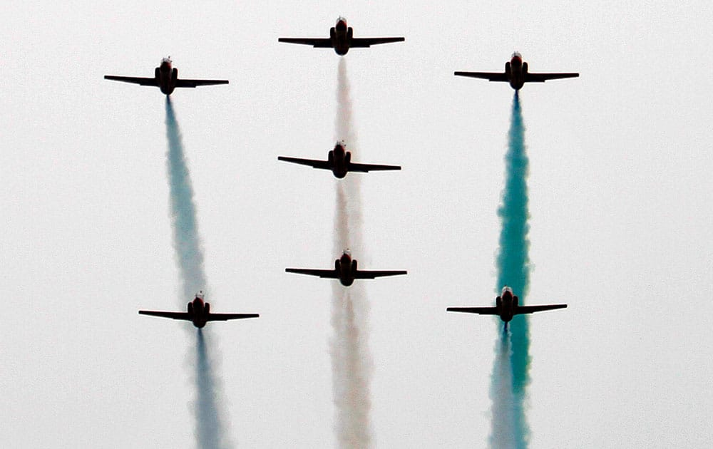 Pakistani Air Force planes fly in formation over the presidential palace during a ceremony marking National Day in Islamabad.