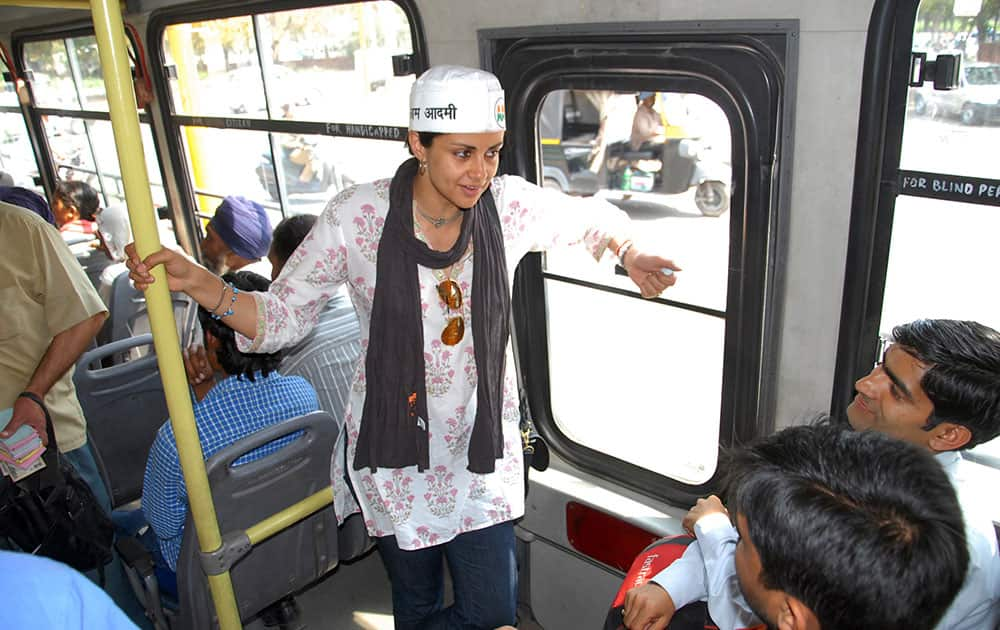 Aam Aadmi Party, or Common Man Party, nominee and former Miss India Gul Panag campaigns on a public bus in Chandigarh.