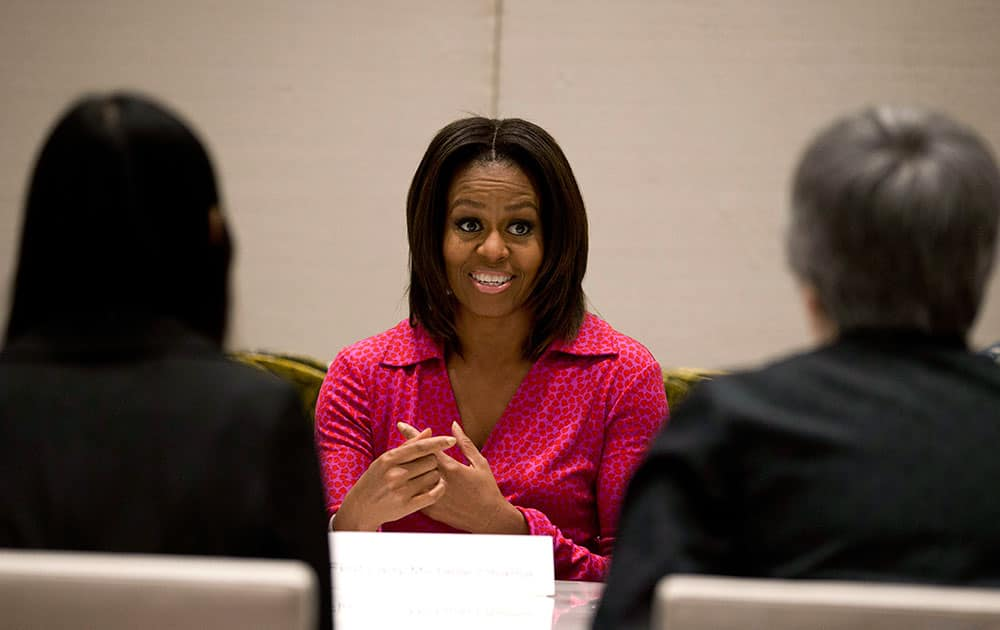 US first lady Michelle Obama, center, speaks during a round table discussion on education at the US Embassy in Beijing, China.
