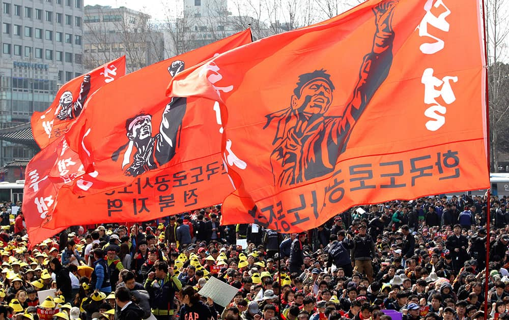 Workers stage a rally against the government`s labor policy in Seoul, South Korea.